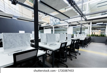 World pandemic, remote work. Light modern open space office with computers, no people