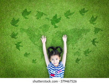 World peace day, international day of peace, and universal children's day concept with peaceful mind kid resting in clean natural environment on eco friendly world map green lawn