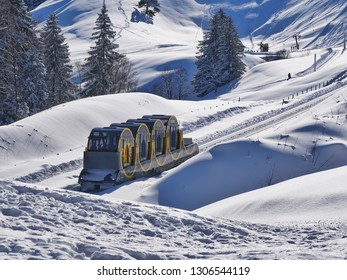 The world record breaking Stoosbahn mountain railway ascends to Stoos ski resort and village through spectacular scenery, deep snow and ski runs.
