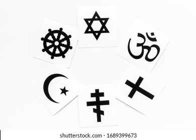 World religions concept. Christianity, Catholicism, Buddhism, Judaism, Islam symbols on white background top view