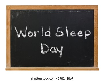 World sleep day written in white chalk on a black chalkboard isolated on white