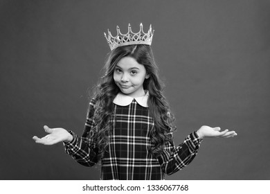 World spinning around me. Kid wear golden crown symbol princess. Every girl dreaming become princess. Lady little princess. Girl wear crown red background. Spoiled child concept. Egocentric princess.