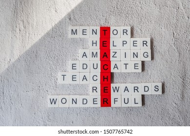 World teachers day crossword made from wooden letters on white background. Greeting card concept. Minimalism, soft focus, copy space, top view.