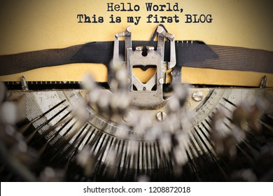 """Hello world, this is my first blog"" introduction written with classic vintage typewriter on weathered paper"