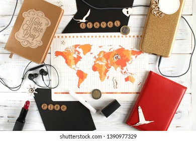 World time zones. Map and elements of tourism. Passport, notebook, headphones