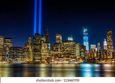 World Trade Center 911 Lights over Manhattan buildings off East River at night in New York City