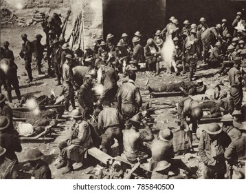 World War 1: American Red Cross First-Aid station in French town on the Western Front. Badly wounded soldiers have just been brought in from the battlefield on stretchers, while others, slightly wound