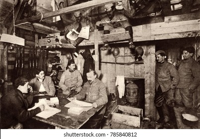 World War 1: Battle of Verdun. French officers working on their maps and reports in a heated dugout near Verdun on the Western Front. Ca. 1915-17.