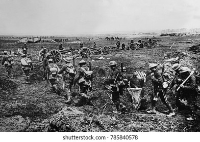 World War 1. British Empire forces grouping near Arras to attack German defenses. The infantry going to the communication trenches, the artillery and a tank are coming into action, the cavalry in the