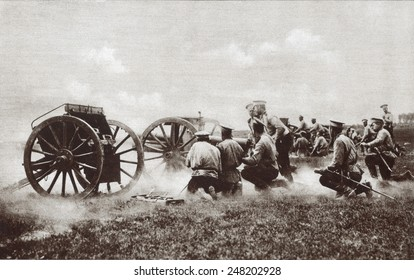World War 1. The fire of a Russian field battery directed by officers kneeling in the rear of their squads. Probably during either the 1914 or 1916 Russian invasion of East Prussia.