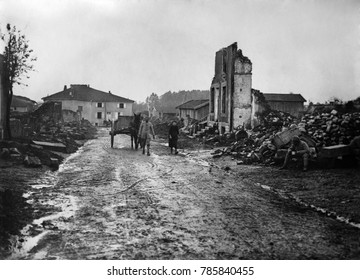 World War 1. A French couple lead their horse and wagon through the ruins of the village of Albert. The German army captured and looted the town in March 1918 during the Spring Offensive. Photo possib