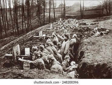 World War 1. German machine guns in a trench near Darkehmen in East Prussia. A wounded soldier receives medical attention. Possibly during either the 1914 or 1916 Russian invasion of East Prussia.