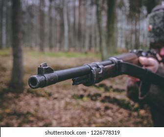 World War 1 historical reenactor holds german Mauser K98 rifle in a historical reenactment event outdoors