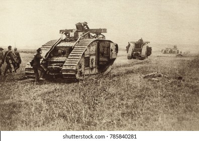 World War 1 Tanks. British tanks advancing in battle, leaving behind them the dead bodies of Germans who a few minutes before attacked the tank. 1917-18.