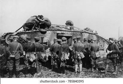 World War 1 Tanks. German soldiers standing on and around a tank with an Iron Cross insignia. It is one of approximately 50 British tanks captured, repaired, and used in battle by the Germans. Ca. 191