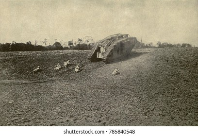 World War 1 Tanks. U.S. soldiers (107th Infantry, 27th Division) advancing toward the Hindenburg Line from behind the shelter of a British tank. 1918