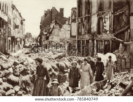 World War 1. Women and children who had been hiding in the cellars of Chateau-Thierry, France, emerging after the Allies liberated the city in July 1918.