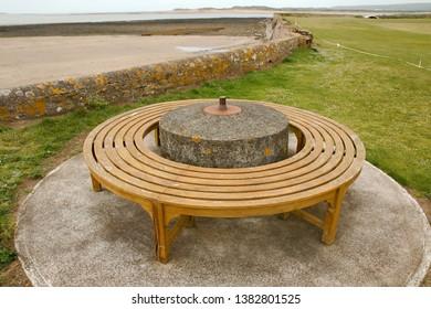 A World War 2 era anti-tank spigot mortar base, with a modern bench around it
