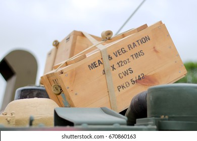 World war 2 era ration pack in a crate on an armoured vehicle from the same period.