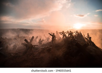 World War 2 reenactment (D-day). Creative decoration with toy soldiers, landing crafts and hedgehogs. Battle scene of Normandy landing on June 6, 1944. Selective focus