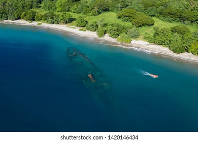 world war 2 ship wreck on beautiful beach view from above