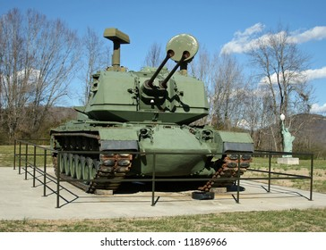 World War I Army Tank ( M247 Sergeant York DIVAD) On Public Display - Miniature Statue Of Liberty Visible In Background