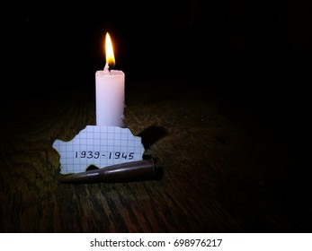 World War II anniversary dates, lit candle and bullet