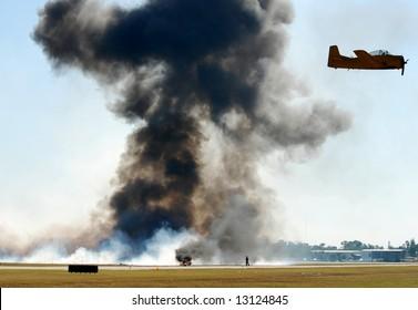 World War II era airplane dropping bombs