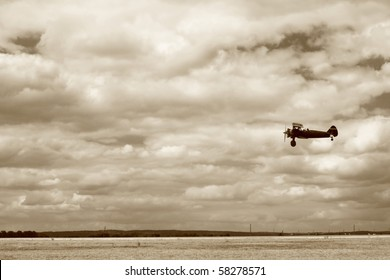 World War II fighter flying at low altitude, performing a fly-by. The ground is not totally crisp because of a slight panning. No sharpening was applied.