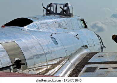 World War II Flying Fortress B-17 with blue sky and clouds in the background