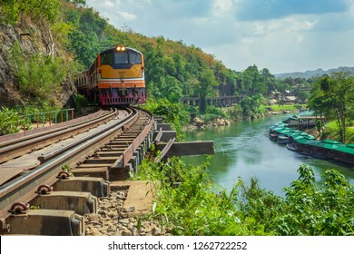 World war II historic railway, known as the Death Railway with a lot of tourists on the train taking photos of the view.