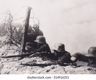 World War One German soldiers firing from a trench