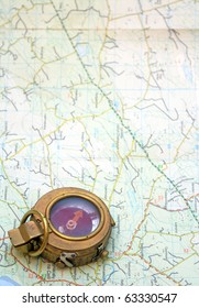 A world War two compass on a map