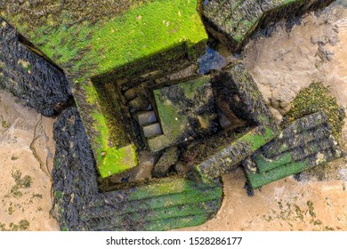 World War Two pill box on the beach at Walton on the Naze. Originally on top of the cliff, coastal erosion has caused the pill box to collapse onto the foreshore, creating Escher like patterns