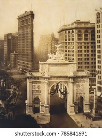World War I Victory Arch, on Fifth Avenue near Madison Sqaure Park in 1919. In the near distance is the Flatiron Building, built in 1902 by architect Daniel Burnham. Photo by Irving Underhill