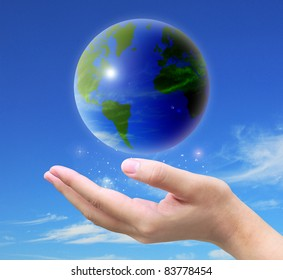 world and women hand holding on blue sky