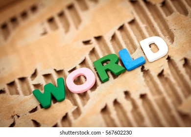 World wording on abstract torn cardboard background