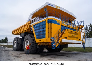 Worlds Largest Huge Truck BelAZ with man for scale. Zodzina, Belarus - March 9, 2016: Haul truck BelAZ 75710 by Belarusian manufacturer BelAZ with man for scale.