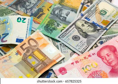 World's major currencies American dollar, Euro money, Australian dollar and Chinese yuan as money background.