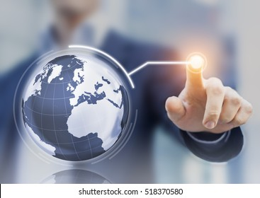Worldwide business concept with 3D globe interface and businessman touching a button, global economy