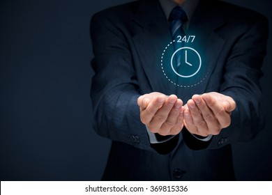 Worldwide nonstop (full time, 24/7) service concept. Businessman hand with symbol of on worldwide 24/7 service. Wide banner composition with bokeh in background.