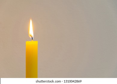 Worm atmosphere near the burning yellow candle.