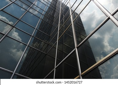 Worm eyes view of glass building exterior, skyscraper facade at day time. high rise office building.