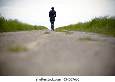 Worms eye view woman walking away