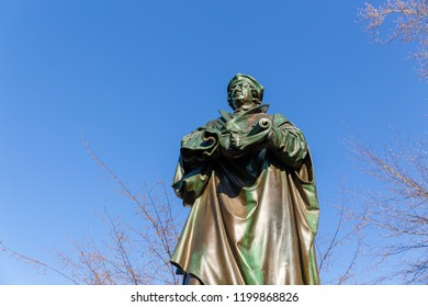 Worms, Germany - April 04, 2018: bronze sculpture of the Luther monument. Martin Luther was a German professor of theology, composer, priest, monk, and a seminal figure in the Protestant Reformation
