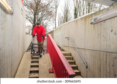 Worms, Germany - December 1, 2010: Old man having difficulties to move barrier-free though his city