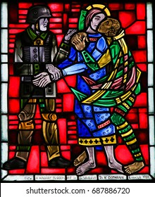 WORMS, GERMANY - JULY 4, 2017: Stained Glass in Wormser Dom in Worms, Germany, depicting the traitor Judas kissing Jesus on the Mount of Olives