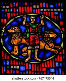 WORMS, GERMANY - JULY 4, 2017: Stained Glass in Wormser Dom in Worms, Germany, depicting the Prophet Daniel in the Lions Den, as told in the Book of Daniel