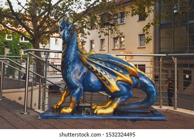 Worms, Germany - October 2019: Sculpture of a blue 'Lindworm' dragon, inaccurately depicted with wings, in city center of Worms, dedicated to Germanic heroic 'Nibeungen' legend