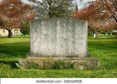 Worn blank tombstone in a cemetery